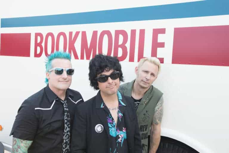 Green Day standing by the Bookmobile
